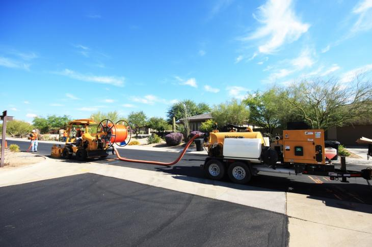A microtrenching train works on a residential street.