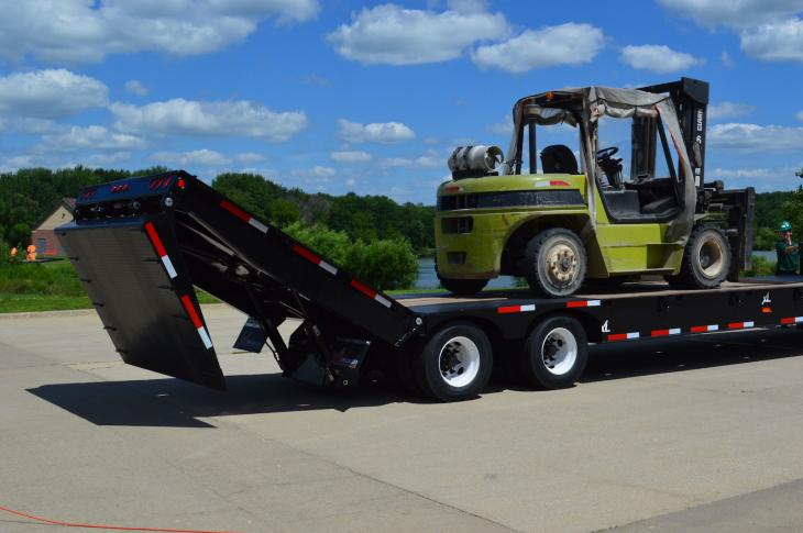 The XL 80 Power Tail trailer has a hydraulic fold-under flip tail ramp to assist in loading