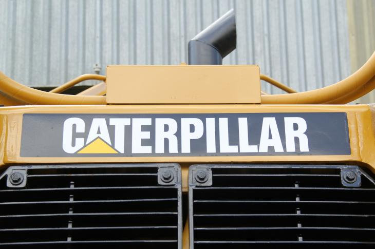 Close up of a Caterpillar machine logo.