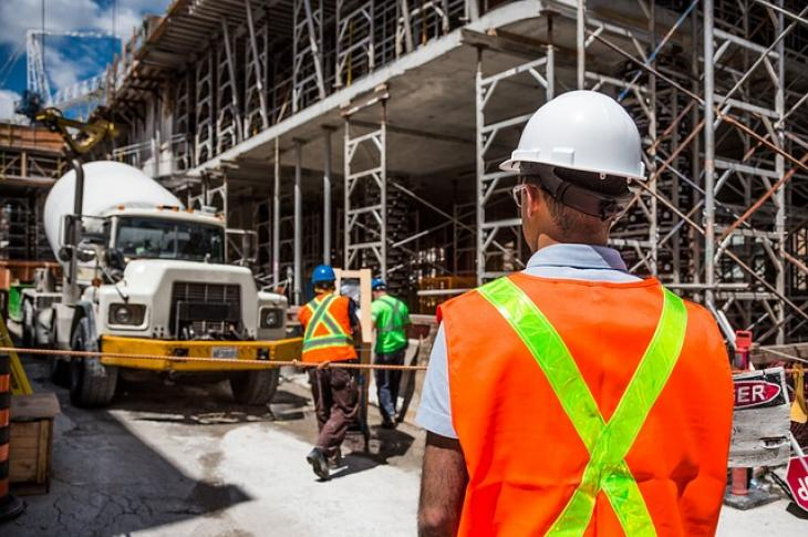 Construction worker on site wearing a hardhat.