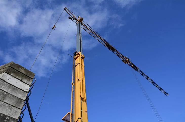 Crane on site against a blue sky.
