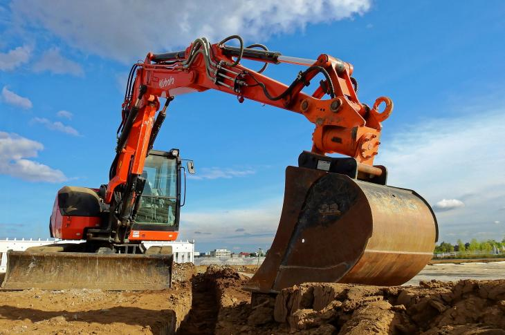 Komatsu machine digging on site.