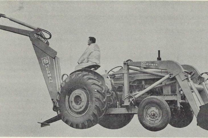 A Fordson Major tractor equipped with a Sherman Products F9 Major Digger and 1400 Series Loader.