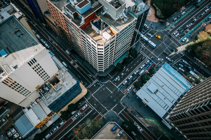 Shot from above of buildings and an intersecting urban streets.