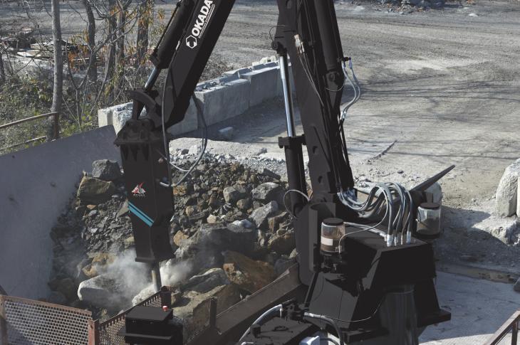 Okada Pedestal Rock Breaker Boom System includes a positioning pedestal boom