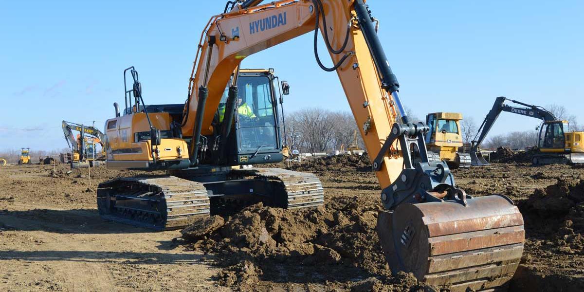 Hyundai HX220L excavator digs in frozen ground