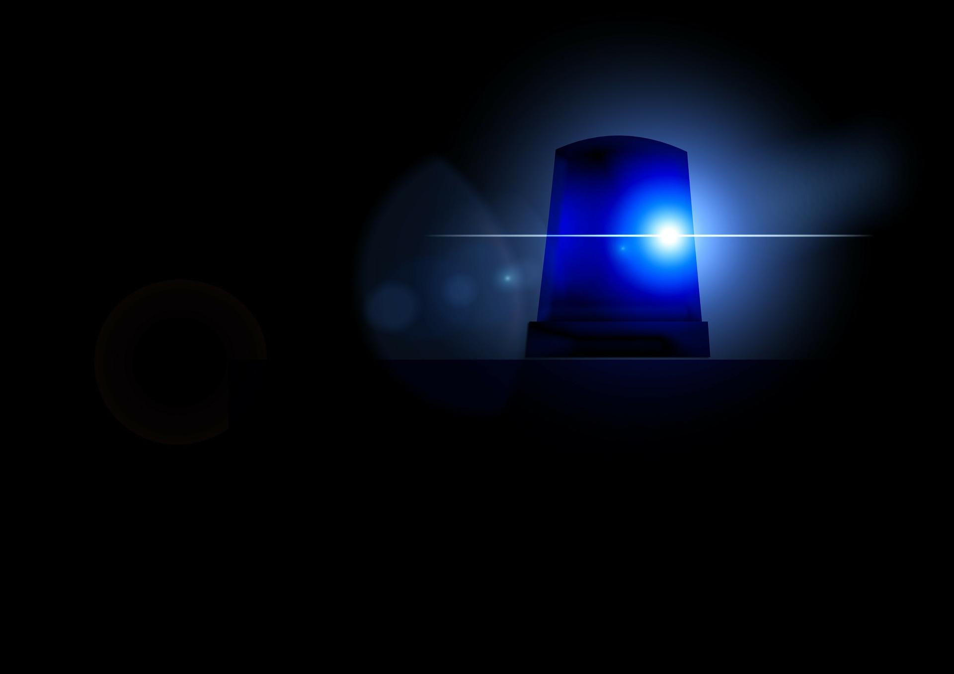 Police light bright against a dark backdrop.