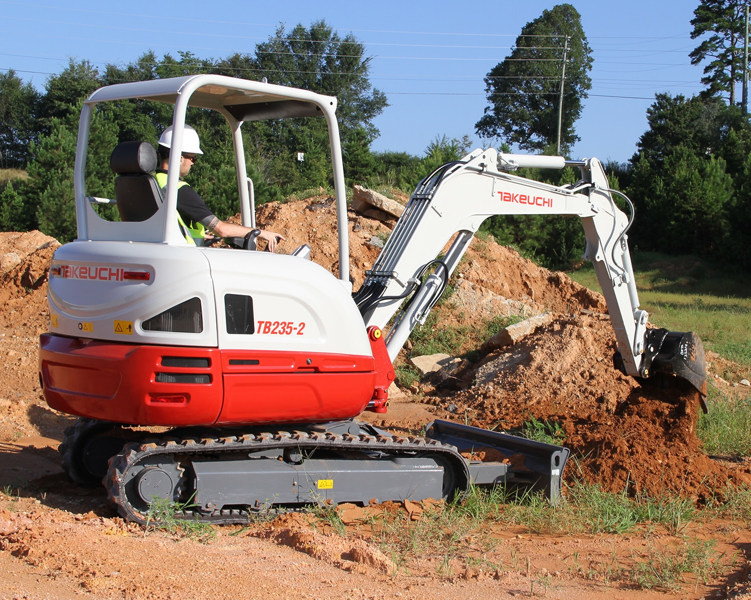 Takeuchi machine in action on site.