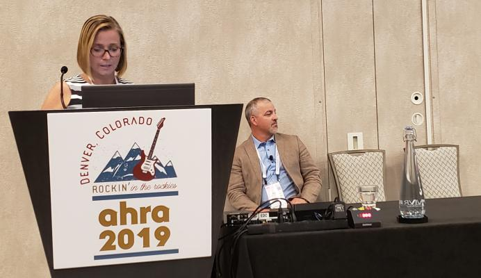 Ali Westervelt presents information at AHRA 2019 supporting the value of FFR-CT as a noninvasive cardiac test for patients at moderate risk of coronary artery disease. Her co-presenter, Curt Bush, looks on. Photo by Greg Freiherr