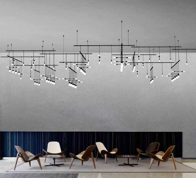 Suspenders fixtures over chairs