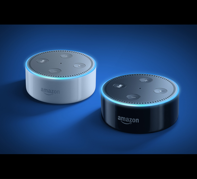 Two Amazon Echo dots on a blue background