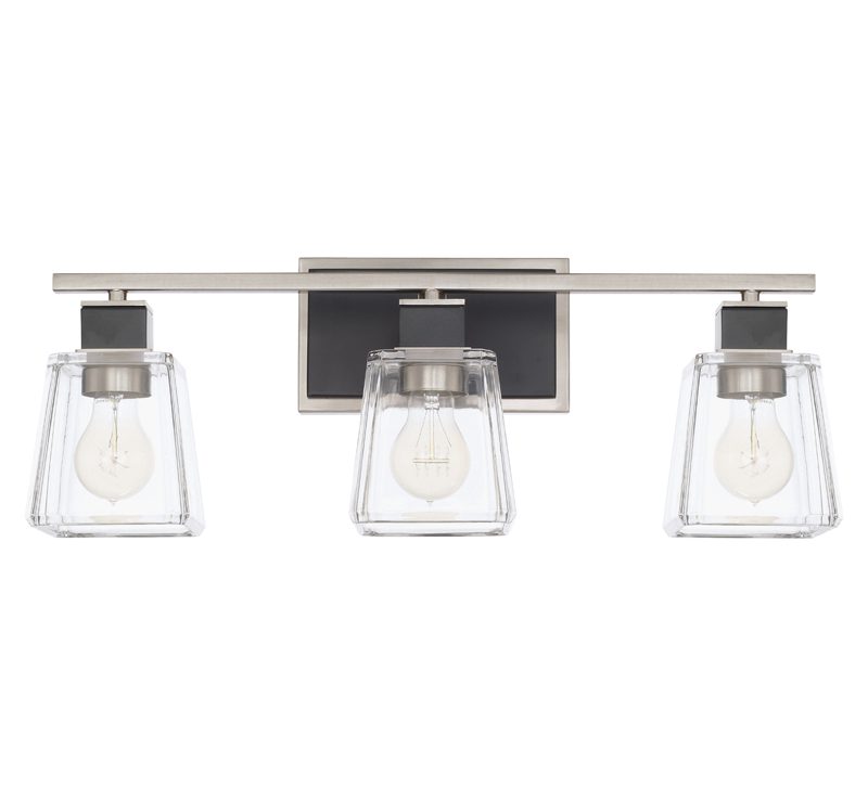 Tux three-light vanity light with glass surrounding the three bulbs and black accents on the metal from Capital lighting Fixture Co.