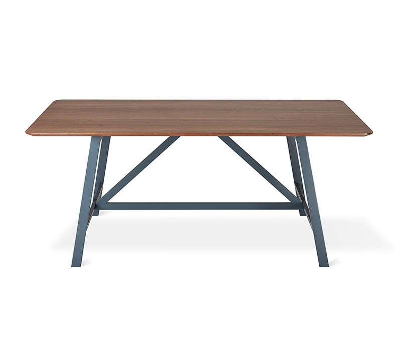 Wychwood Dining Table with a Walnut top and gray steel frame from Gus Modern
