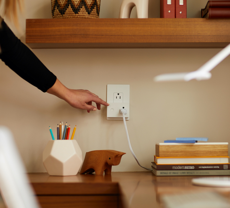 Woman using Legrand smart lighting switch