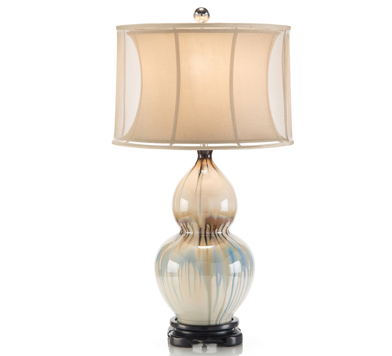 John-Richard Ceramic Glazed Table Lamp with a traditionally carved base and shade from John-Richard