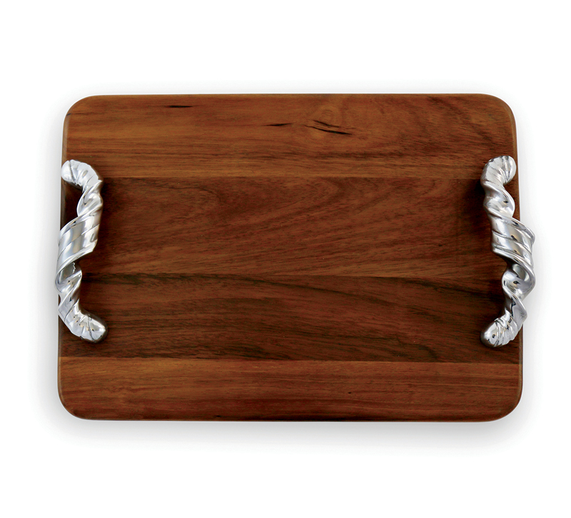 Brown Soho cutting board with silver ribbon handles from Beatriz Ball