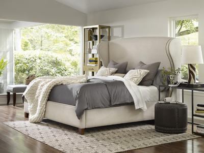 Nest Theory headboard in gray on a bed, designed by Hooker Furniture
