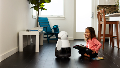 Child playing with a Kuri robot by Mayfield