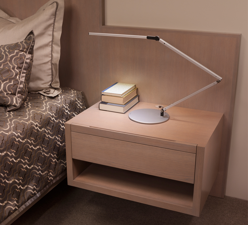 Thin LED bedside table lamp in bedroom