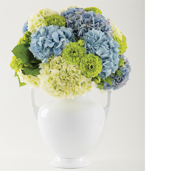 White vase with blue, white and green flowers
