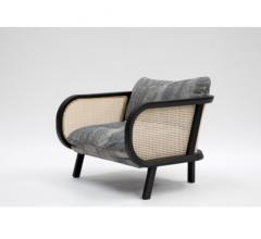 BuzziCane Chair with cane sides and gray fabric from BuzziSpace