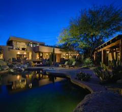 Outside of a home with landscape lights on. Photo: Jeff Zaruba