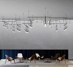 Suspenders fixtures over chairs