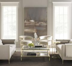 Living room featuring two Caracole sofas, accent chairs and tables