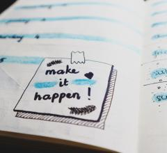 High Point Market book planner with Make It Happen post-it note