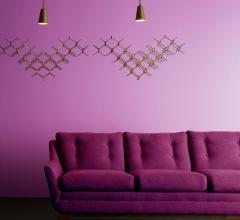 Hive pendant in gold from Vermont Modern hung in a living room with a violet wall and purple couch
