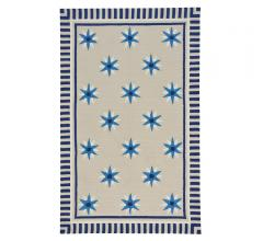 Compass Quilt Area Rug on a beige background with blue and white stars from Capel Rugs