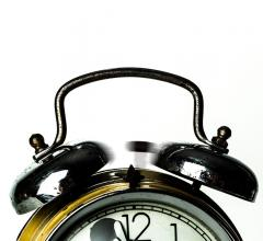 Top half of an alarm clock that is ringing