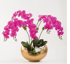 pink orchids in gold scalloped bowl