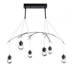 Kiwi Pendant with six lights suspended from two downrods with a branch-like sculpture draped across all lights from Vermont Modern
