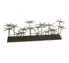 Andromed tabletop accessory with 16 decorative spikes on a slab of iron from Regina Andrew Design