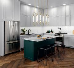 Kitchen with white cabinets and a gold linear pendant