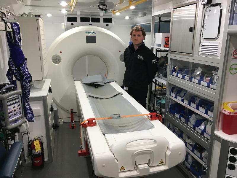 Peter Juodka, RT(CT) operates the 16-slice Siemens Somatom Scope CT scanner in the mobile stroke unit to assess stroke patients immediately at the call site.
