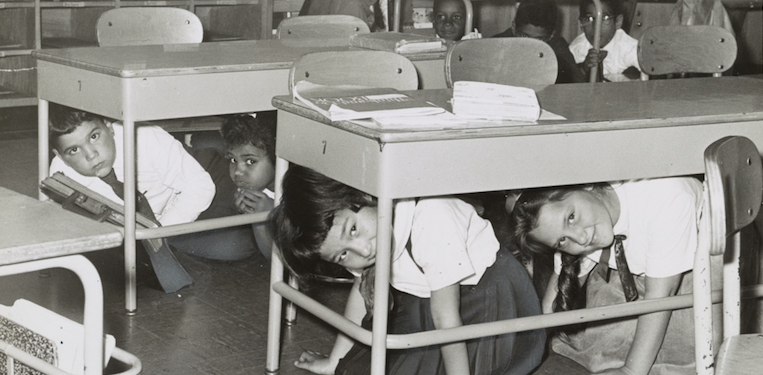 Nuclear attack drill, kids under desks