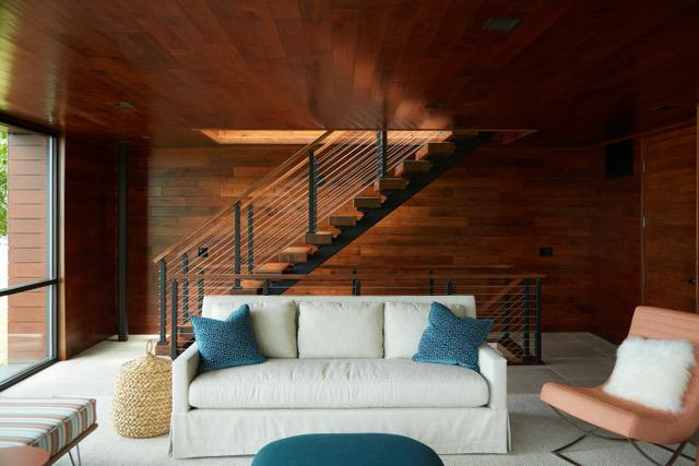 FLIGHT floating stairs and glass railing preserve views