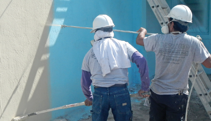painting stucco wall on jobsite