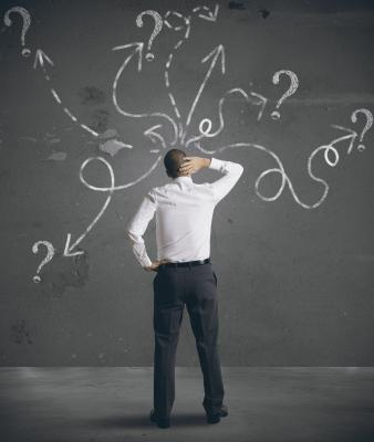 solve sales and marketing problem_identify problem_Man at chalkboard, scratching head (Photo: alphaspirit / 123RF)