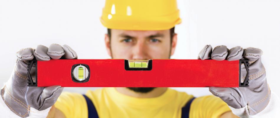construction worker holding spirit level