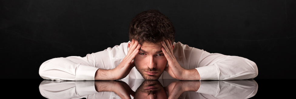 man stressing over sales cycles