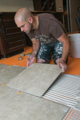 How Uncoupling Membranes for Tile Floors Work | Professional Builder