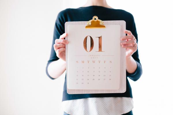 Woman holding up January 2019 calendar