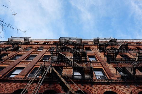 Building exterior | Multifamily real estate had one of its best since 2000:multifamily debt hit an all-time high, renters paid more for housing than ever, and deliquencies remained at historic lows.