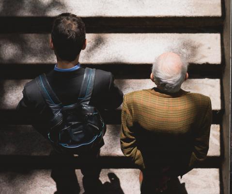 Younger and older gentlemen on steps