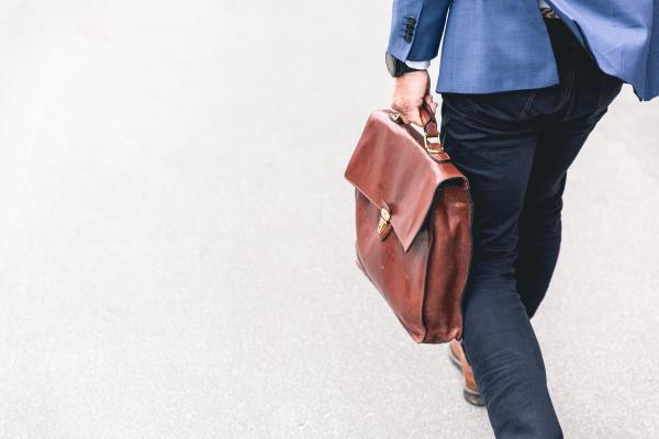 Businessman with briefcase walking