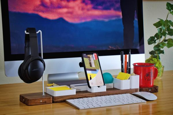 Desk with computer and other office supplies