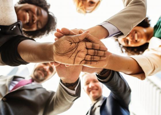 Team together (Photo: Unsplash/Rawpixel)